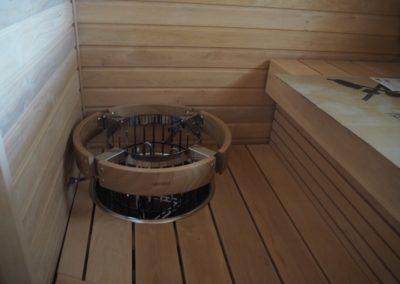 Sauna upotetulla kiukaalla.